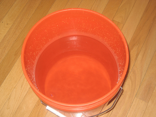 use a bucket or container to dip water out of your aquarium and pour it back in and repeat